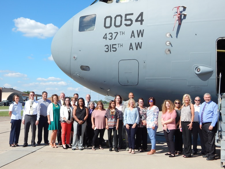 Local college representatives and school superintendents, administrators, and support staff pose for a group photo during Educators' Day, Sept. 14, 2018, at Scott Air Force Base, Illinois. Educators' Day is a chance for wing leadership to meet with local educators and discuss school quality and teacher licensing issues that affect military families.