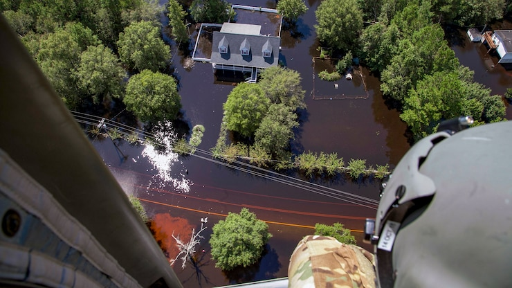 National Guardsmen fly over areas affected by Hurricane Florence.