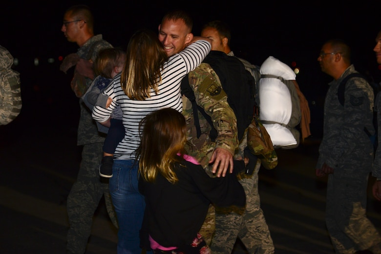 Master Sgt. Steven Graff, the 28th Maintenance Squadron noncommissioned officer in charge of egress, hugs his family as he lands back at Ellsworth Air Force Base, S.D., after a six-month deployment to Al Udeid Air Base, Qatar, Sept. 18, 2018. The 28th Bomb Wing deployed B-1s, Airmen and support equipment to fly missions in the U.S. Central Command area of responsibility. (U.S. Air Force photo by Senior Airman Denise M. Jenson)