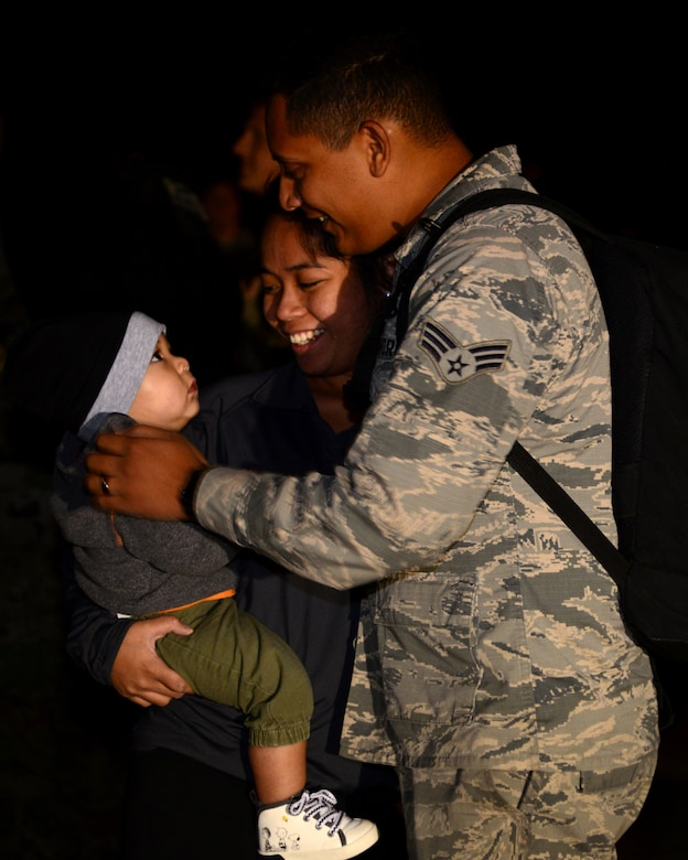 Senior Airman Michael Cardines, a 28th Aircraft Maintenance Squadron aircraft maintenance journeyman, hugs his family after returning home to Ellsworth Air Force Base, S.D., from a six-month deployment to Al Udeid Air Base, Qatar, Sept. 18, 2018. During the deployment, Ellsworth AFB aircrews provided theater commanders with critical long-range strike capability, persistent presence, large diverse weapons payload and organic sensors. (U.S. Air Force photo by Senior Airman Denise M. Jenson)