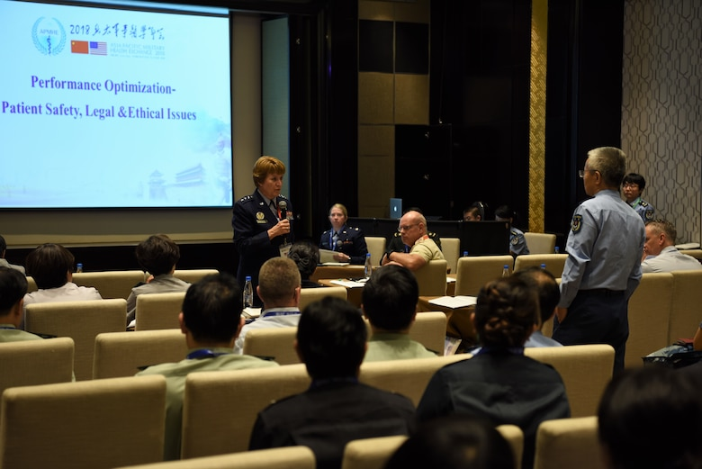 Lt. Gen. Dorothy Hogg, U.S. Air Force Surgeon General, answers a question from an attendee at the Asia Pacific Military Health Exchange (APMHE) 2018, in Xi'an, China Sept. 17, 2018.