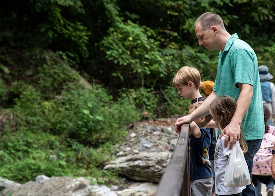 U.S. Air Force Capt. Joshua Hammans, a 35th Fighter Wing chaplain, and his children, look at a water stream during a 35th Fighter Wing chapel resiliency trip, at Ichinoseki, Japan, Sept. 15, 2018. The chapel took approximately 40 active-duty personnel and their dependents to Geibikei Gorge and Chuson-Ji Temple, Hiraizumi, Japan, in order to strengthen their spiritual and social aspects of the Comprehensive Airmen's Fitness pillars. According to Air Force studies, when Airmen are spiritually, physically, mentally and socially resilient, they reach optimal performance in their daily tasks, better executing the mission. (U.S. Air Force photo by Senior Airman Sadie Colbert)