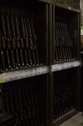 M16 A4 service rifles are stored in numbered slots with in the armory Sept. 19, 2019 at Camp Foster, Okinawa, Japan.