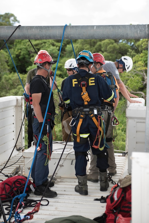 Firefighters from installations across Okinawa participate in rappelling training Sept. 14, 2018, at Kadena Air Base, Japan. Firefighters use rappelling skills in situations requiring access to areas not accessible by foot.