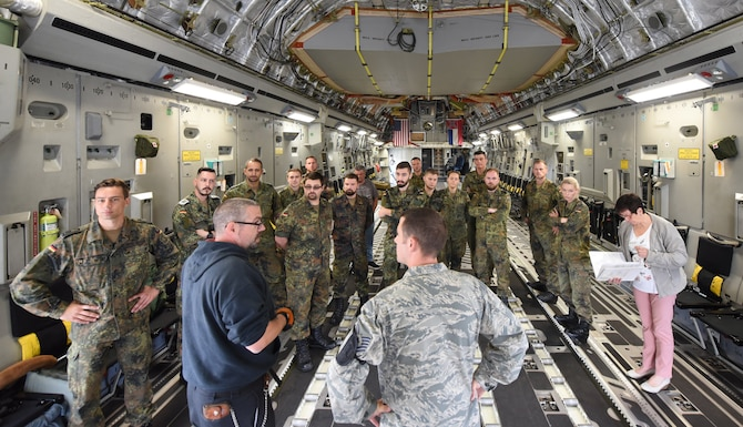 U.S. Air Force Technical Sgt. Alex Rose, 721st Aerial Port Squadron Ramp Service Supervisor, gives German Forces loadmasters a tour inside the static C-17 Globemaster on Ramstein Air Base, Germany, Sep. 13, 2018. These kinds of exercises mutually benefit the United States and Germany by further establishing cooperation and transparency between the two countries.