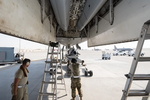 Weapons load crews assigned to the 9th Expeditionary Bomb Squadron conduct a training exercise on the B-1B Lancer with inert munitions at Al Udeid Air Base, Qatar, Sept. 13, 2018. The event involved reconfiguring the aircraft with inert munitions to maintain a high state of readiness. The B-1B Lancer carries the largest conventional payload of both guided and unguided weapons in the Air Force inventory and is the backbone of America's long-range bomber force. It can rapidly deliver massive quantities of precision and non-precision weapons against any adversary, anywhere in the world, at any time. Its armaments include up to 24 AGM-158A Joint Air-to-Surface Standoff Munitions. (U.S. Air Force photo by Tech. Sgt. Ted Nichols/Released)