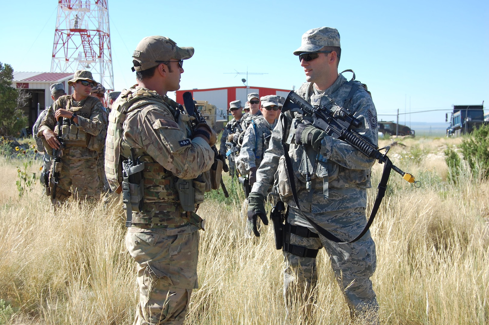 """Master Sgt. Richard """"Dick"""" Gibbons, EOD flight chief, 140th Explosive Ordnance Disposal Flight, works with Tech. Sgt. Andrew Wise, patrolman, 140th Security Forces Squadron, 140th Wing, Colorado Air National Guard, on squad movement tactics during a training day August 4 at Airburst Range, Fort Carson, Colo. (US Air National Guard photo by Capt. Kinder Blacke)"""