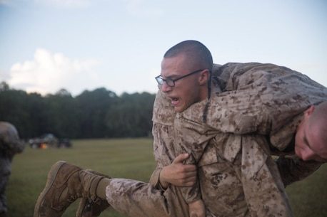 "Recruit Ethan Gemzik with Platoon 3080, Mike Company, 3rd Recruit Training Battalion conducts a ""fireman carry"" during the Marine Corps Martial Arts Program Endurance Course Sep. 08, 2018, on Marine Corps Depot Parris Island, S.C."