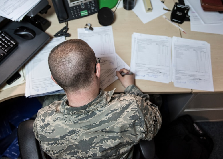 U.S. Air Force Senior Airman Charles Bower, 39th Contracting Squadron contracting specialist, fills out end of fiscal year requests at Incirlik Air Base, Turkey, Sept. 19, 2018.