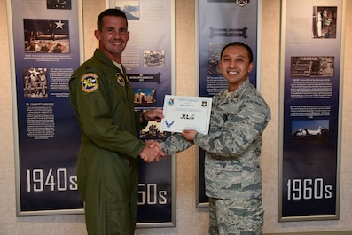 """Maj. (Dr.) Phong Ngo, 47th Medical Operations Squadron physician, was chosen by wing leadership to be the """"XLer"""" of the week, for the week of Sept. 10, 2018, at Laughlin Air Force Base, Texas. The """"XLer"""" award, presented by Col. Charlie Velino, 47th Flying Training Wing commander, is given to those who consistently make outstanding contributions to their unit and the Laughlin mission. (U.S. Air Force photo by Airman 1st Class Marco A. Gomez)"""