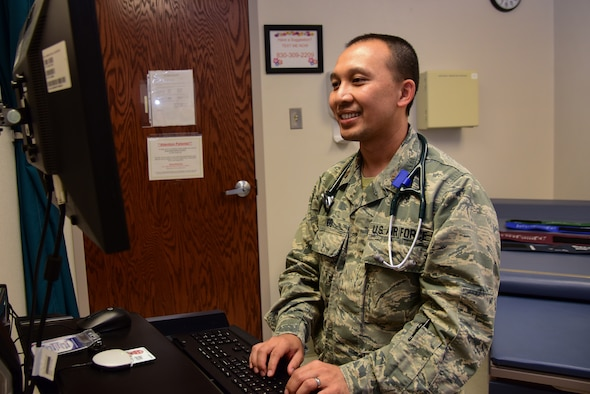 "Maj. (Dr.) Phong Ngo, 47th Medical Operations Squadron physician, enters a patient's information into a medical records program, Sept. 18, 2018, at Laughlin Air Force Base, Texas. ""The challenging aspect is finding the amount of time and being efficient to try to handle everything, because we're such a small base, we have to learn to coordinate with outside providers and specialists to get the patients the care they need,"" Ngo said. (U.S. Air Force photo by Airman 1st Class Marco A. Gomez)"