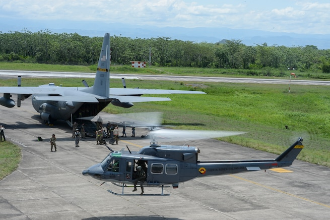 A Colombian Air Force UH-1H Huey II launches after transporting simulated earthquake victims to a U.S. Air Force C-130 Hercules for aeromedical evacuation at Air Combat Command number 1, German Olano Air Base, Colombia, for the search and rescue exercise Angel de los Andes, Sept. 6, 2018. The two-week Colombian-led exercise has more than 400 participants from 12 nations training together in the air and on the ground in the event of a humanitarian assistance and disaster relief response. (U.S. Air Force photo by Tech. Sgt. Angela Ruiz)
