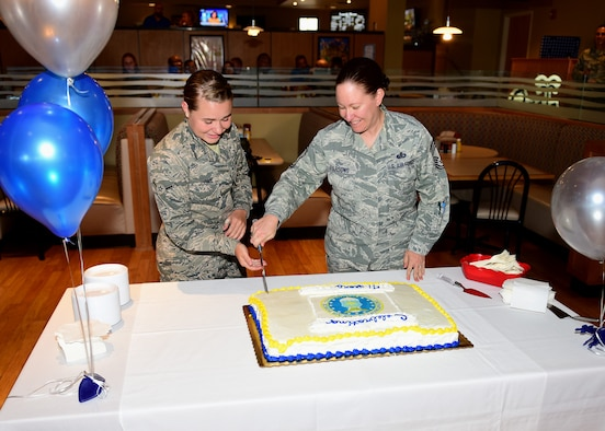 U.S. Air Force Airman Abbey Judah, 325th Force Support Squadron services specialist, and Chief Master Sgt. Tarah Baxley, 325th Medical Group superintendent, cut a ceremonial cake at Tyndall Air Force Base, Fla., Sept. 18, 2018. It is tradition for the youngest and oldest enlisted Airmen at the cake cutting ceremony to cut the cake together in honor of the Air Force birthday. (U.S. Air Force photo by Senior Airman Isaiah J. Soliz)