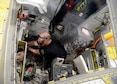 James Goers, aircraft ordnance mechanic, works on a B-1 ejection system.