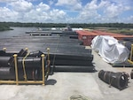 Donjon's barge loaded with piping, CONEX boxes, pumps and spare parts prior to sailing from Morgan City, LA