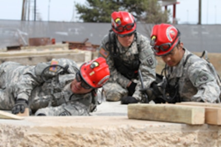 Colorado search and extraction Soldiers assess a rubble pile during a training exerciser April 12-14, 2013, at the West Metro Fire Training Center in Lakewood, Colo., in preparation for this summer's multi-state National Guard Bureau evaluation. The service members, including Airmen, all trained in chemical, biological, radiological, nuclear and high-yield explosives, represent the state's CBRNE Enhanced Response Force Package and are held responsible for responding to state emergencies. (Photo by Army National Guard Spc. Zach Sheely/RELEASED)