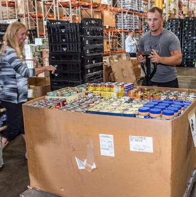 Volunteers unload donations for Feds Feed Families