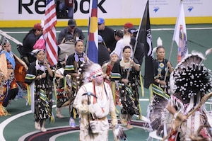 Members of the Sister Nations Color Guard, Colorado Army National Guard Staff Sgt. Cindy Littlefeather, Glenda Littlebird, Sgt. 1st Class Toni Eaglefeathers, and Carissa Gonzales, display the colors as part of a Native American presentation during halftime at a Colorado Mammoth versus Rochester Knight Hawks lacrosse game, March 2, 2012, at the Pepsi Center in Denver. The Sister Nations is a group of current and former Native American Soldiers who perform traditional dance and color guard. (Army National Guard photo by Capt. Michael Odgers/Released)