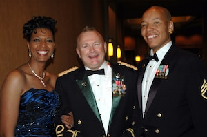 (Left to right) Darlene Jenkins, Col. Donald P. Laucirica and then Staff Sgt. Mark Jenkins share a smile during the Colordao Military Ball, March 31, 2012 in Westminster, Colo. (Photo provided by Col. Donald P. Laucirica/Used with permission)