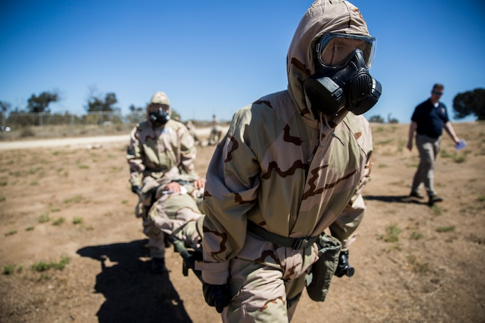 U.S. Marine Corps Base Camp Pendleton, CA – Marines with 3rd Battalion, 5th Marine Regiment, 1st Marine Division, carry a simulated casualty of a chemical agent attack to the decontamination front line on Camp Pendleton, Calif., Sept. 14, 2018.