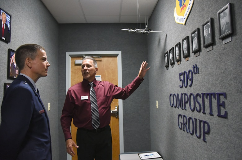 Patrick Myers, 334th Training Squadron command and control operations apprentice course master instructor, provides a tour to U.S. Air Force Brig. Gen. Paul W. Tibbets IV, Air Force Global Strike Command deputy commander, Barksdale Air Force Base, Louisiana, during a room dedication ceremony at Cody Hall on Keesler Air Force Base, Mississippi, Sept. 14, 2018. The dedication honored Tibbets' grandfather, retired Brig. Gen. Paul W. Tibbets Jr., by dedicating the 334th Training Squadron Command and Control simulator in his name. Tibbets Jr., piloted the Enola Gay, which dropped the world's first atomic bomb. (U.S. Air Force photo by Kemberly Groue)