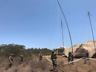 Bravo Company Marines raise antennas aboard Camp Pendleton to provide single channel radio communications