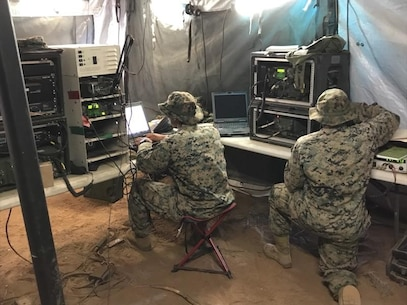 Bravo Company Marines program and monitor single channel and multi-channel communications
