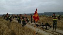 Bravo Company conducts boots and utilities physical training in the hills of Camp Pendleton
