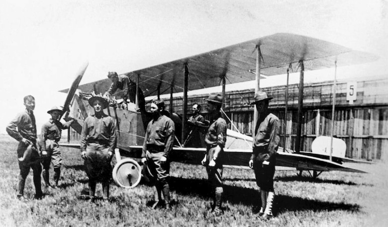 The first Curtiss JND2s of 1st Aero Squadron at the Signal Corps Aviation School, North Island, Cali., Sgt. Vernon L. Burge stands under the propeller. In the cockpit is Capt. Benjamin Foulois and second man from the right is Jacob Bollinger. (Vernon L. Burge Collection/Airman Memorial Museum Courtesy Photo)