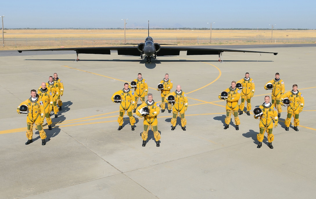 U-2S Dragon Lady Intelligence, Surveillance and Reconnaissance Aircraft instructor pilots from the 1st Reconnaissance Squadron pose for a photo in front of a two seat U-2S August 17, 2012 at Beale Air Force Base, Calif. Less people have piloted the U-2 than have earned Super Bowl rings. (U.S. Air Force photo by Mr. John Schwab)
