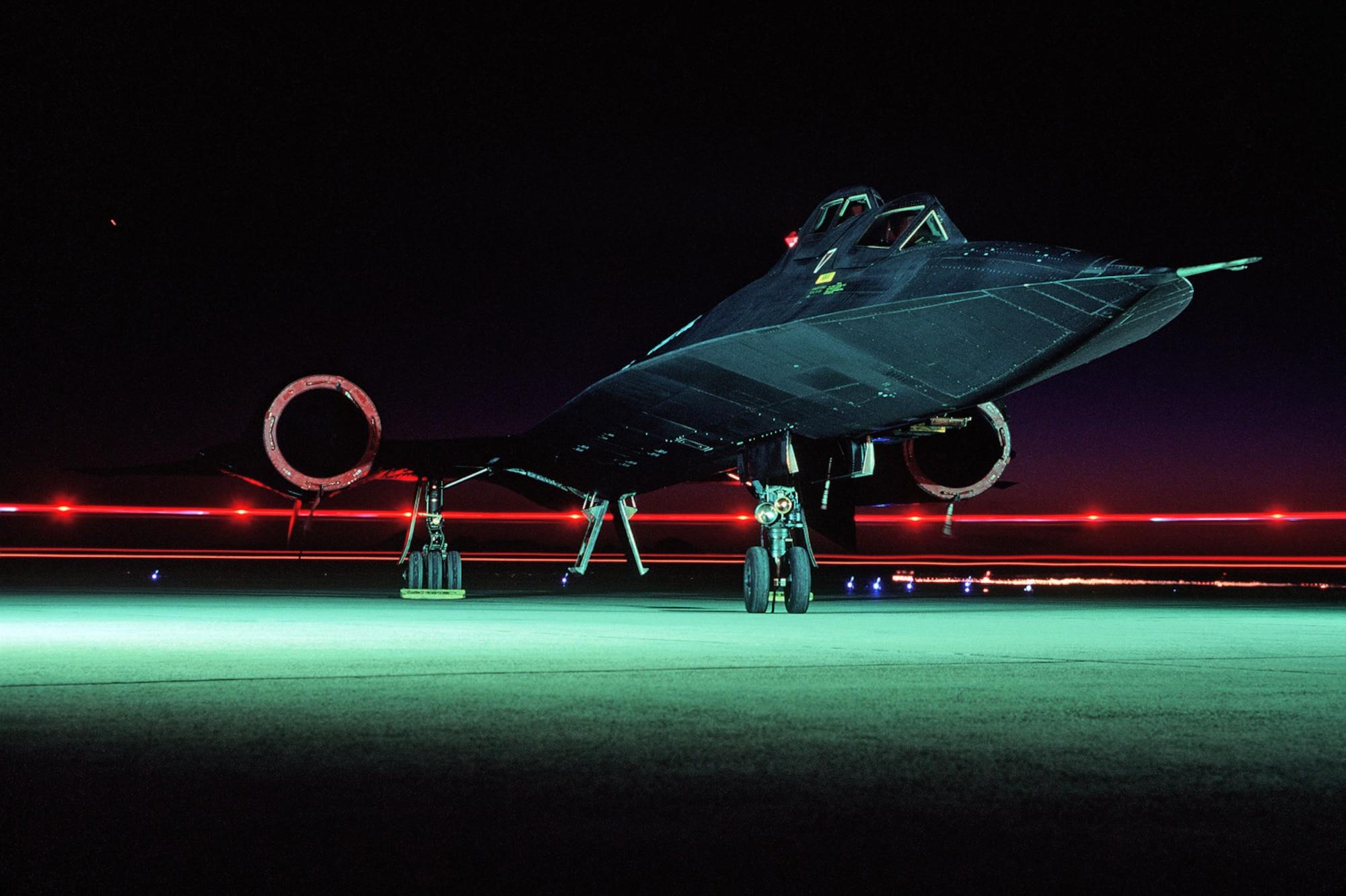 An SR-71B Blackbird sits on the runway after sundown. (Courtesy photo)