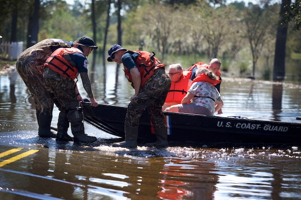 Members of the Coast Guard's Gulf Strike Team rescue an elderly couple after floodwaters from Tropical Storm Florence overwhelmed their apartment complex in Horry County, S.C., Sept. 19, 2018. Coast Guard photo by Petty Officer 1st Class Jon-Paul Rios.