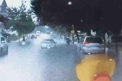 Massachusetts Guard member helps a neighbor in flood