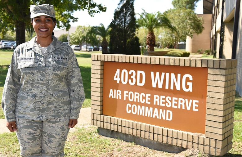 Tech Sgt. Dishau R. JeanJacques, a member of the 403d Force Support Squadron at Keesler Air Force Base, Miss., poses for a picture in front of the wing's headquarters September 19, 2018. JeanJacques was recently selected as the new coordinator for the Yellow Ribbon Reintegration Program for the 403rd Wing. (U.S. Air Force photo by Senior Airman Kristen L. Pittman).