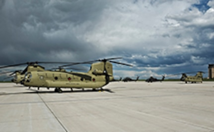 Four Boeing CH-47F Chinook aircrews arrived at the Colorado Army National Guard Aviation Support Facility for the first time with new F-model Chinooks May 17, 2013, at Buckley Air Force Base, Colo. The crews returned to Colorado with the new helicopters after attending a seven-week training course at Hunter Army Airfield, Ga. (U.S. Air Force photo by Airman 1st Class Riley Johnson/Released)