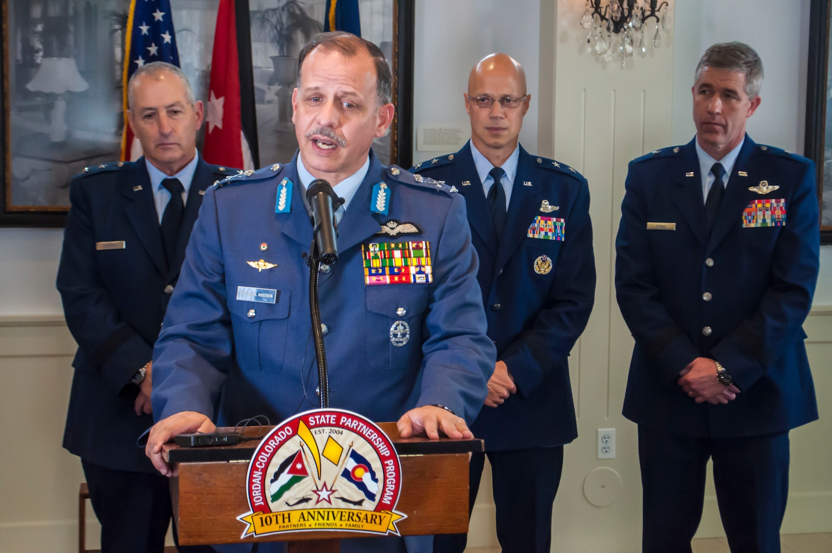"""His Royal Highness Lt. Gen. Prince Feisal bin Al-Hussein speaks, at a news conference, about the current struggles in the Middle East, saying that the """"United States has an ally in Jordan.""""  Behind Feisal are: Maj. Gen. H. Michael Edwards, the Adjutant General of Colorado; Maj. Gen. Douglas McGregor, the National Guard Bureau director of Strategic Policy, Plans and International Affairs; and Brig. Gen. Peter Byrne, director of Joint Staff for the Colorado National Guard.  In recognition of the 10th Anniversary between the Hashemite Kingdom of Jordan and the Colorado National Guard, Feisal and Maj. Gen. Mansour Al-Jobour, the commander fo the Royal Jordanian Air Force, visited Colorado and attended an office call with Colorado Gov. John Hickenlooper, escorted by Edwards.  (U.S. Air National Guard Photo by Capt. Darin Overstreet /RELEASED)"""