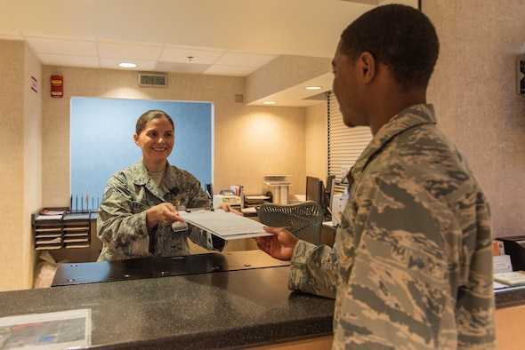Tech. Sgt. Nicole Rogers, 47th Medical Group family health and flight medicine office manager, checks in a patient at the clinic at Laughlin Air Force Base, Texas, Sept. 18, 2018. Rogers was recently recognized and promoted to technical sergeant through the Stripes for Exceptional Performers program—a program designed to early promote enlisted Airmen who demonstrate exceptional potential. (U.S. Air Force phot by Senior Airman Daniel Hambor)