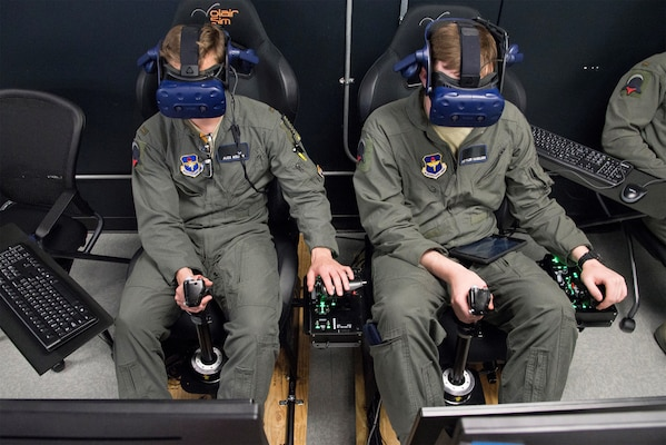 U.S. Air Force Second Lt. Charles Keller and Airman First Class Tyler Haselden, Pilot Training Next students, train on a virtual reality flight simulator at the Armed Forces Reserve Center in Austin, Texas, June 21. Air Education and Training Command officials announced the second iteration of Pilot Training Next would begin in January 2019 during a panel at the 2018 Air Force Association Air, Space and Cyber Conference in National Harbor, Maryland.