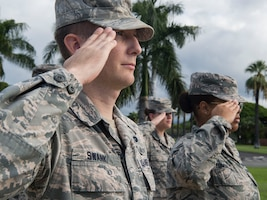 Tech. Sgt. Skylar Swank, 15th Wing general law paralegal, salutes the flag during the Reveille Ceremony for Prisoners of War and Missing in Action Week, Joint Base Pearl Harbor-Hickam, Hawaii, Sept. 17, 2018.  The ceremony kicked off the observances for the weeklong events commemorating those who were prisoners of war or classified as missing in action. The events include readings of the POW/MIA names, a reveille ceremony, beautification of POW/MIA memorial, information tables, sentinel posting, a 24-hour run, and ends on Friday with a POW/MIA Remembrance Ceremony at the National Memorial Cemetery of the Pacific in Honolulu. Observances of National POW/MIA Recognition Day are held across the country on military installations, ships at sea, state capitals, schools and veterans facilities. It is traditionally observed on the third Friday in September each year. (U.S. Air Force photo by Tech. Sgt. Heather Redman)