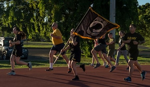 Members from the Defense POW/MIA Accounting Agency kick off the 24-hour run for Prisoners of War and Missing in Action Week, Joint Base Pearl Harbor-Hickam, Hawaii, Sept. 20, 2018.  There were seven military service men from Hawaii who were prisoners of war, missing in action, or whose bodies were never recovered. From Sept. 17-21, events will be held throughout JBPHH as part of POW/MIA Recognition Week. The events include readings of the POW/MIA names, a reveille ceremony, beautification of POW/MIA memorial, information tables, sentinel posting, a 24-hour run, and ends on Friday with a POW/MIA Remembrance Ceremony at the National Memorial Cemetery of the Pacific in Honolulu. Observances of National POW/MIA Recognition Day are held across the country on military installations, ships at sea, state capitals, schools and veterans facilities. It is traditionally observed on the third Friday in September each year. (U.S. Air Force photo by Tech. Sgt. Heather Redman)