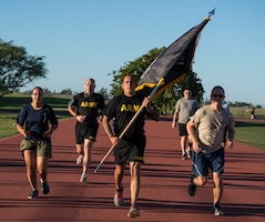 Members from the Defense POW/MIA Accounting Agency kick off the 24-hour run for Prisoners of War and Missing in Action Week, Joint Base Pearl Harbor-Hickam, Hawaii, Sept. 20, 2018.  Throughout the day participants will take shifts running around the Hickam Field track in remembrance of America's prisoners of war, those who are still missing in action and their families. From Sept. 17-21, events will be held throughout JBPHH as part of POW/MIA Recognition Week. The events include readings of the POW/MIA names, a reveille ceremony, beautification of POW/MIA memorial, information tables, sentinel posting, a 24-hour run, and ends on Friday with a POW/MIA Remembrance Ceremony at the National Memorial Cemetery of the Pacific in Honolulu. Observances of National POW/MIA Recognition Day are held across the country on military installations, ships at sea, state capitals, schools and veterans facilities. It is traditionally observed on the third Friday in September each year. (U.S. Air Force photo by Tech. Sgt. Heather Redman)