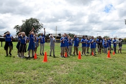 Students attending STARBASE Goodfellow watch as their water-bottle rockets fall after being launched at Goodfellow Air Force Base, Texas, Sept. 12, 2018. The children learned about Newton's Laws and used the rockets as a hands-on demonstration of the concepts. (U.S. Air Force photo by Airman 1st Class Zachary Chapman/Released)