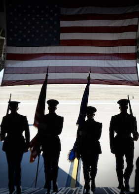 U.S. Air Force Honor Guard members carry flags up the ramp of a C-17 for a retirement ceremony March 5, 2018, Altus Air Force Base, Okla. Honor Guard members perform in ceremonies in order to honor both Air Force heritage and fallen service members. (U.S. Air Force photo by Airman 1st Class Jeremy Wentworth)