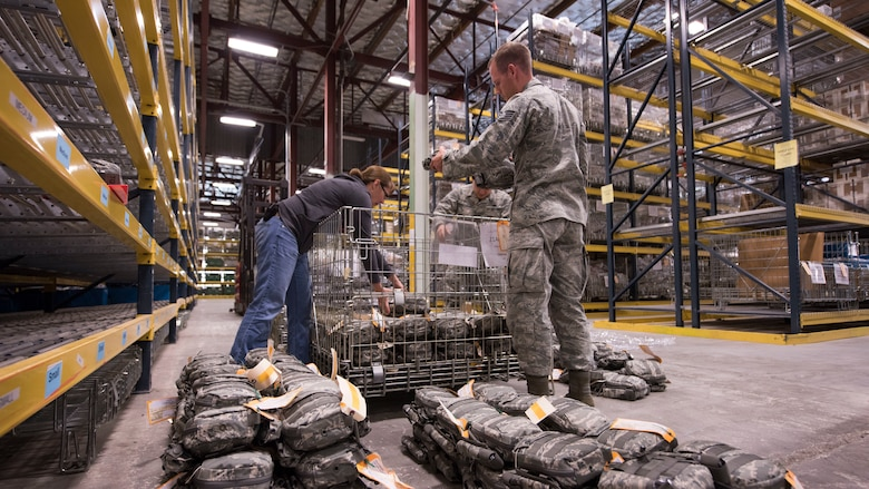 Jessica Parker, 92nd Logistics Readiness Squadron Individual Protective Equipment supply technician supervisor (left), Airman Diego Najera-Dominguez, 92nd LRS IPE apprentice, and Staff Sgt. Jeffery Jones, 92nd LRS IPE supervisor, sort through Joint First Aid Kit packages Sept. 19, 2018, at Fairchild Air Force Base, Washington. IPE gear is cleaned, inspected and returned to storage each and every time it is issued to help ensure the safe functionality of items such as armor, gas masks and weapons. (U.S. Air Force photo/Senior Airman Ryan Lackey)