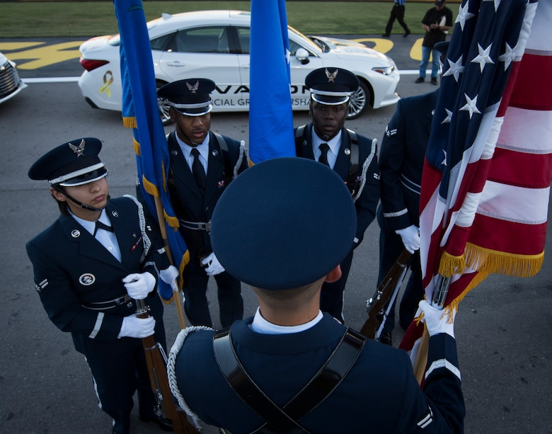 Nellis Honor Guardsmen perform final checks before presenting the colors at the South Point 400 NASCAR race opening ceremonies at the Las Vegas Motor Speedway, Sept. 14, 2018. Presenting the colors requires a team of five ceremonial guardsmen. (U.S. Air Force photo by Airman 1st Class Andrew D. Sarver)