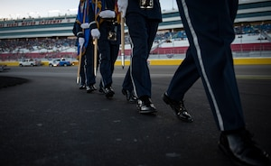 Nellis Honor Guardsmen march in formation after presenting the colors at the South Point 400 NASCAR race opening ceremonies at the Las Vegas Motor Speedway, Sept. 14, 2018. Presenting the colors is one of many details the team performs. (U.S. Air Force photo by Airman 1st Class Andrew D. Sarver)