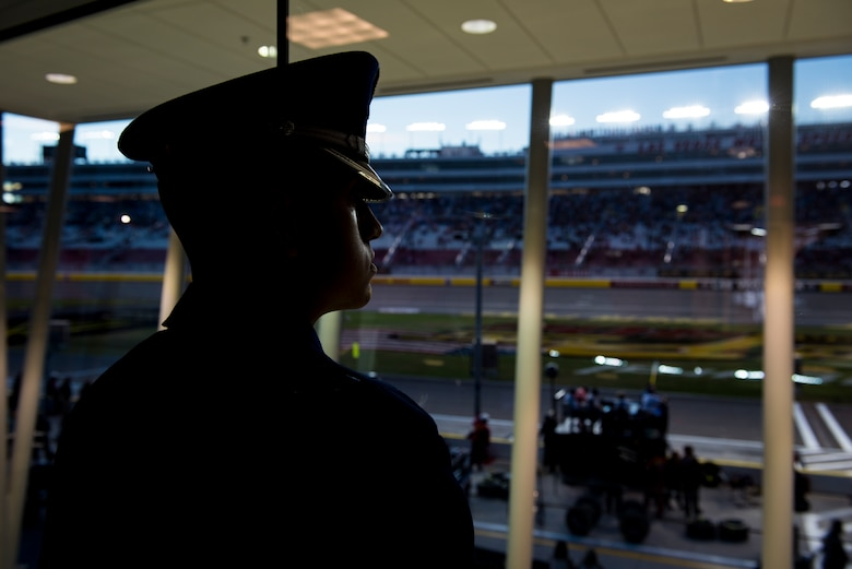 Airman 1st Class David Diez, Nellis Air Force Base honor guardsman, looks out a window at the Las Vegas Motor Speedway, Sept. 14, 2018. Diez spends dozens of hours each week perfecting his skills and cleaning his uniform. (U.S. Air Force photo by Airman 1st Class Andrew D. Sarver)