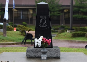 A prisoner of war and missing in action memorial sits outside the base theater at Osan Air Base, Republic of Korea, Sept. 20, 2018. According to the Defense POW/MIA Accounting Agency, more than 82,000 Americans remain missing from WWII, the Korean War, Vietnam War, Cold War, Gulf Wars and other recent conflicts. (U.S. Air Force photo by Staff Sgt. Sergio A. Gamboa)