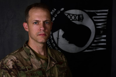 U.S. Air Force Lt. Col. Powell, 387th Air Expeditionary Squadron commander, poses for a portrait at an undisclosed location in Southwest Asia, Sept. 21, 2018. National POW/MIA Recognition Day is held each year on Sept. 21. There are currently more than 82,000 Americans missing from past conflicts dating back to World War II. (U.S. Air Force photo by Staff Sgt. Christopher Stoltz)