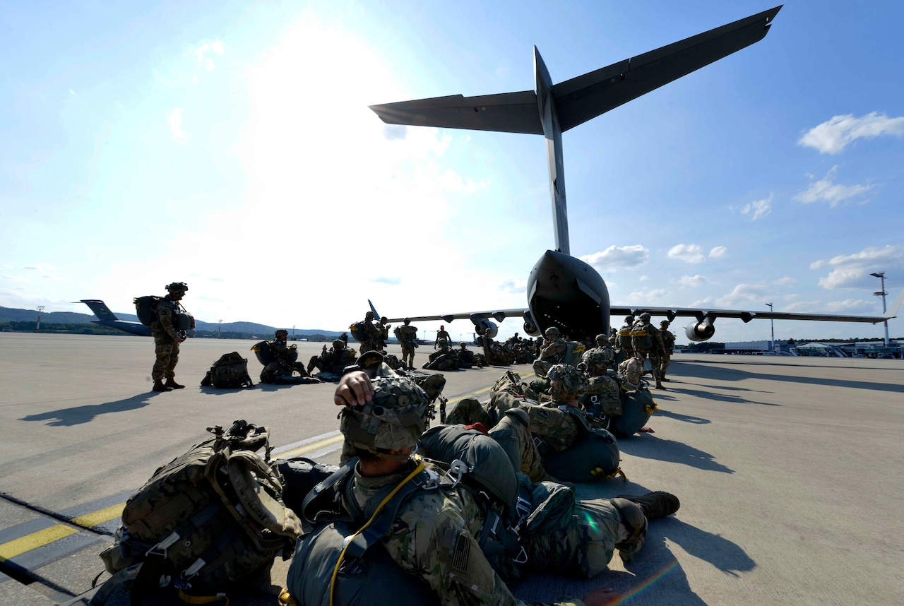 U.S. and Italian soldiers wait to load onto a C-17 Globemaster III as part of Exercise Saber Junction 18 at Ramstein Air Base, Germany, Sept. 19, 2018. Allies and partners use the opportunity provided by the exercises to work through their own training objectives while also working on interoperability solutions. Air Force photo by Senior Airman Alexis Schultz